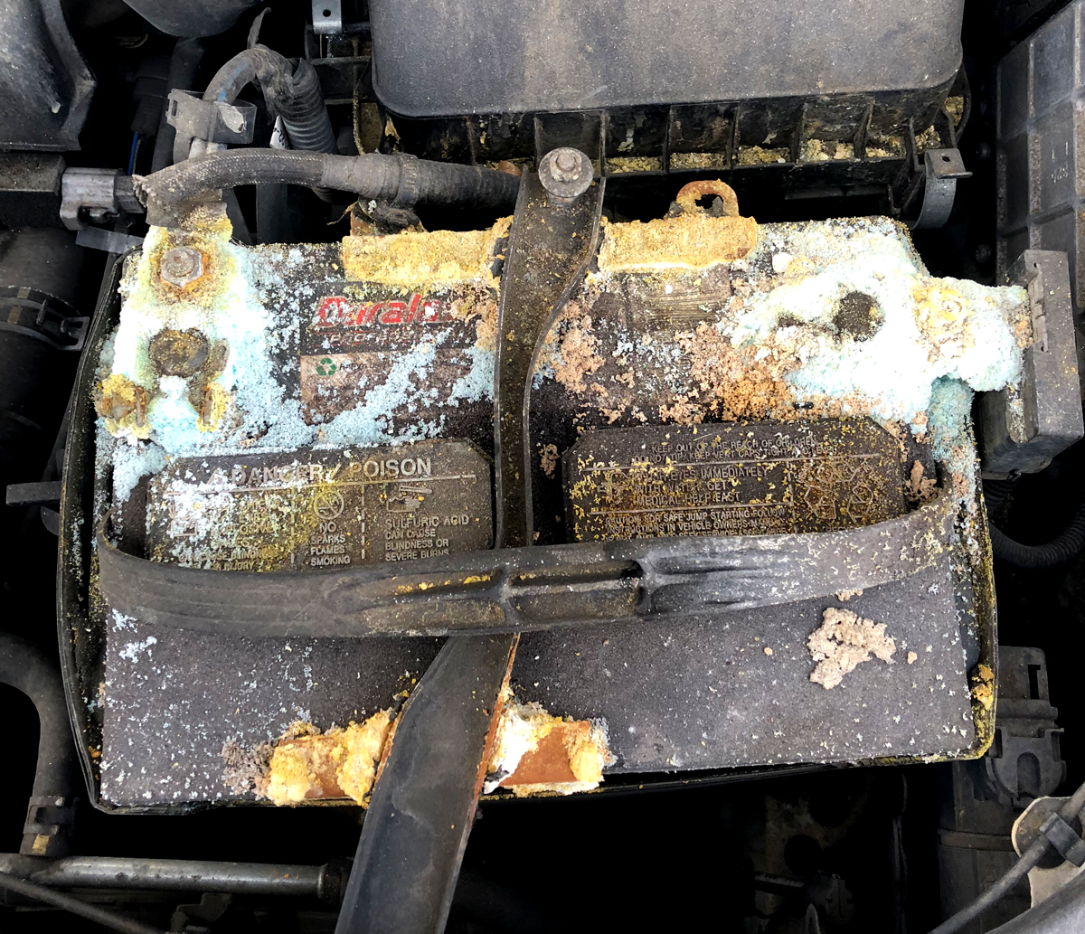 Dead corroded battery in car